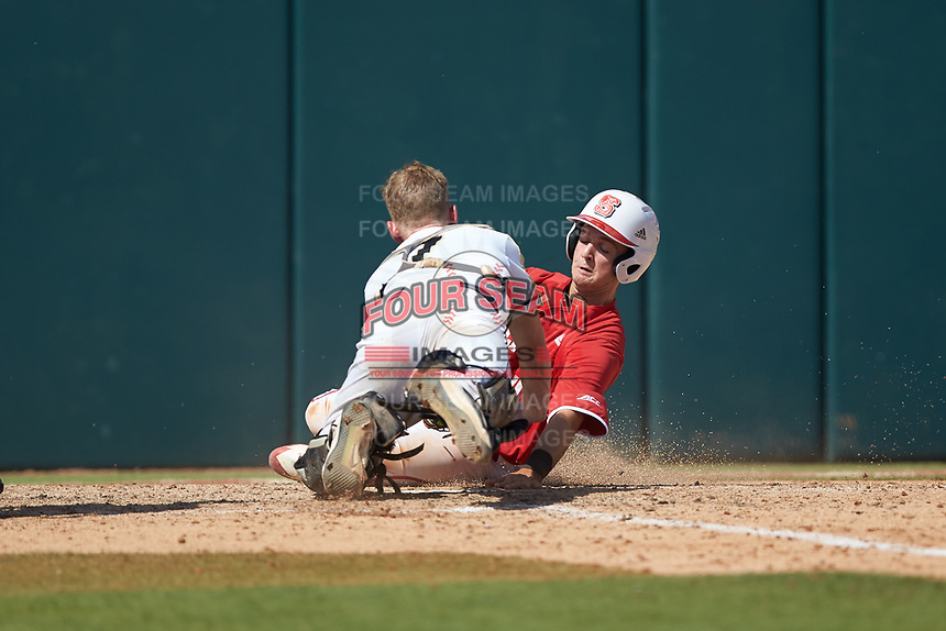 Will Wilson (8) of the North Carolina State Wolfpack slides into home plate as Army Black Knights catcher Jon Rosoff (7) applies a tag at Doak Field at Dail Park on June 3, 2018 in Raleigh, North Carolina. The Wolfpack defeated the Black Knights 11-1. (Brian Westerholt/Four Seam Images)