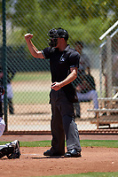 Home plate umpire Bailey Dutten calls a strike during an Arizona League game between the AZL Indians Red and the AZL Indians Blue on July 7, 2019 at the Cleveland Indians Spring Training Complex in Goodyear, Arizona. The AZL Indians Blue defeated the AZL Indians Red 5-4. (Zachary Lucy/Four Seam Images)