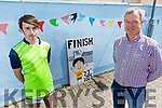 Gene and Andrew O'Connor cross the finish line at the Beale GAA Coiste na nOg fundraising walk, which is the equivalent distance from Ballybunion to Croke Park of 288km of in aid of Pieta House in Ballybunion on Saturday.