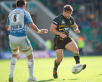 Dom Waldouck of Northampton Saints chips ahead during the Heineken Cup match between Northampton Saints and Glasgow Warriors  at Franklin's Gardens on Sunday 14th October 2012 (Photo by Rob Munro)