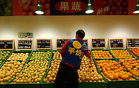 An assistant at the fruit counter of a Wal-mart superstore in the center of Kunming, capital of Yunnan Province, China. An Introduction to Wal-Mart. In 1996, Wal-Mart entered the Chinese market nowadays operate 45 units in 21 cities across the mainland. The American retailer is very popular and is responsible for the closure of many local traditional markets..08 Jul 2005