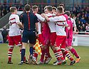 Airdrie and Stirling player clash after Referee Brian Colvin gives Airdrie a second penalty.