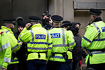 """© Joel Goodman - 07973 332324 . 22/08/2015 . Manchester , UK . Police detain anti-fascists . Far-right nationalist group , """" North West Infidels """" and Islamophobic , anti-Semitic and white supremacist supporters , hold a rally in Manchester City Centre . Photo credit : Joel Goodman"""