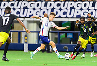 DALLAS, TX - JULY 25: Matthew Hoppe #13 of the United States attempts to dribble the ball around Oniel Fisher #8 of Jamaica during a game between Jamaica and USMNT at AT&T Stadium on July 25, 2021 in Dallas, Texas.