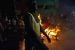 """© Remi OCHLIK/IP3 - Port au Prince on 2010 december 7 - Gunshots, flames and fireworks lit up the night in Haiti as frustration quickly turned into violence following the release of the country's preliminary election results. Angry rioters spilled into the streets of Port-au-Prince shortly after initial results released Tuesday showed that government-backed candidate Jude Celestin and former first lady Mirlande Manigat will advance to a second-round vote in the race for Haitian president. The protesters had hoped to see popular carnival singer Michel """"Sweet Micky"""" Martelly emerge as the outright winner. Bonfires were burning near the Petionville restaurant where the results were announced Tuesday and professed Martelly supporters threw rocks at people passing nearby after the vote was announced..."""