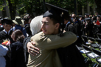 3 June 2011, Cambridge, MA - MIT Commencement...A graduated student receives a hug after the 2011 commencement ceremony at the Massachusetts Institute of Technology...Photo by M. Scott Brauer for MIT News