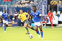 KANSAS CITY, KS - JULY 15: Ricardo Ade #4 of Haiti with the ball during a game between Canada and Haiti at Children's Mercy Park on July 15, 2021 in Kansas City, Kansas.