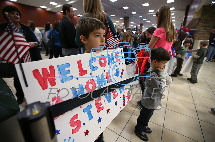 Chris and Kaden Waddell, 7 and 5, of Gardnerville, were among the 300 family, friends and supporters on hand to greet Nevada Army Guard soldiers at the Reno-Tahoe International Airport in Reno, Nev., on Sunday, Feb. 16, 2014. Their uncle Sgt. Steven Minifie is part of the 1/168th General Support Battalion returning from a 10-month deployment in Afghanistan. (Las Vegas Review-Journal/Cathleen Allison)