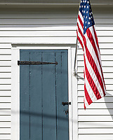 American flag and colonial cottage.