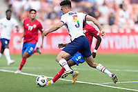 SANDY, UT - JUNE 10: Antonee Robinson #5 of the United States battle for a ball during a game between Costa Rica and USMNT at Rio Tinto Stadium on June 10, 2021 in Sandy, Utah.