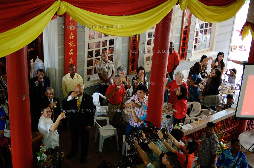 """Chinese Rabbit New Year 2011 celebrated at the complex of  Ngie Kong Tong Sang the oldest Chinese-Surinamese society in Paramaribo. ....Mr.Desiré Delano """"Dési"""" Bouterse President of Suriname, Mr. Yuan Nansheng Ambassador of the People's Republic of China to Suriname, Mr. Yuk Kee Chee chairman of the Chinese socity Ngie Kong Tong Sang sat with Chinese community in Suriname to celebrate Chinese New Year together. Guests and Chinese community had traditional lunch after official speeches and ceremonies.....About the origin of Chinese population in Suriname : When slavery was coming to an end, plantation owners and the Dutch colonial government were making plans in 1853 to bring in contract workers from China to Suriname."""