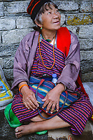 Candid portarit of old lady at traditional Buddhist and social gathering, National Memorial Choeten, Thimpu, Bhutan