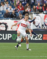 Chicago Fire forward Brian McBride (20) passes the ball as New England Revolution defender Darrius Barnes (25) defends. The New England Revolution out scored the Chicago Fire, 2-1, in Game 1 of the Eastern Conference Semifinal Series at Gillette Stadium on November 1, 2009.