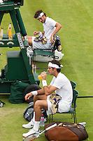 26-06-12, England, London, Tennis , Wimbledon, Robin Haase op de achtergrond tijdens de wissel, op de voorgrond Del Potro