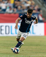FOXBOROUGH, MA - JULY 27: Carles Gil #22 brings the ball forward during a game between Orlando City SC and New England Revolution at Gillette Stadium on July 27, 2019 in Foxborough, Massachusetts.
