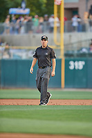 First base umpire Derek Eaton handles the calls on the bases during the game between the Salt Lake Bees and the Memphis Redbirds at Smith's Ballpark on July 24, 2018 in Salt Lake City, Utah. Memphis defeated Salt Lake 14-4. (Stephen Smith/Four Seam Images)