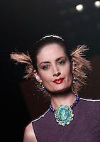 Una modella veste una creazione della collezione Autunno Inverno 2014/2015 Curiel Couture durante la rassegna Altaroma, a Roma, 14 luglio 2014.<br /> A model wears a creation by Curiel Couture's Fall Winter 2014/2015 collection at the Altaroma fashion week in Rome, 14 July 2014.<br /> UPDATE IMAGES PRESS/Isabella Bonotto