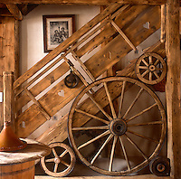 An unusual hand-built wooden staircase with wagon wheel feature. Heartshapes are cut out of the wood that forms the banister panel.