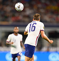 DALLAS, TX - JULY 25: James Sands #16 of the United States heads the ball to a teammate during a game between Jamaica and USMNT at AT&T Stadium on July 25, 2021 in Dallas, Texas.