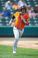 Norfolk Tides designated hitter Dariel Alvarez (12) runs to first base during a game against the Rochester Red Wings on July 17, 2016 at Frontier Field in Rochester, New York.  Rochester defeated Norfolk 3-2.  (Mike Janes/Four Seam Images)