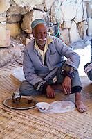 Morocco.  Man Relaxing over Tea, Had Draa Market, Essaouira Province.