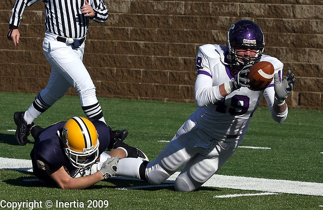 SIOUX FALLS, SD - OCTOBER 31: Kyle Melcher #49 of Winona State is brought down by Nick Weber #9 of Augustana inside the 5-yard line to prevent a touchdown in the third quarter Saturday afternoon at Kirkeby-Over Stadium. (Photo by Dave Eggen/Inertia).