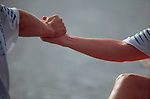 Sports, Rowers congratulating each other with hands joined.