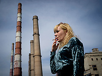Natalia Voronkova, a volunteer who offers support and basic first aid training for Ukrainian government forces fighting Russian-backed separatists in the east of the country. She is smoking while on a break near a factory.<br /><br />The Donbass region is the industrial heart of Ukraine, and much of the country's heavy industry and especially the coal production is located here. So when the Russian-backed separatists took over a large part of the region it was not only a blow to Ukrainian sovereignty but also its economy.
