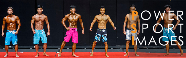 A bodybuilder competes in the Men's Sport Physique 170cm or above (Group B) category during the 2016 Hong Kong Bodybuilding Championships on 12 June 2016 at Queen Elizabeth Stadium, Hong Kong, China. Photo by Lucas Schifres / Power Sport Images