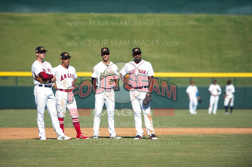Mesa Solar Sox infielders Bobby Dalbec (11), Jahmai Jones (9), Eli White (21), and Josh Ockimey (28) during an Arizona Fall League game against the Surprise Saguaros at Sloan Park on November 1, 2018 in Mesa, Arizona. Surprise defeated Mesa 5-4 . (Zachary Lucy/Four Seam Images)