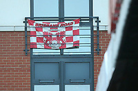 An Orient flag on a balcony adjaent to the ground during Leyton Orient vs Crawley Town, Sky Bet EFL League 2 Football at The Breyer Group Stadium on 19th December 2020