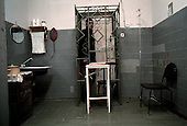 Nizhniy Novogrod, Russia..TB prisoners wait in small cages to be given injection treatments.