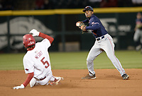 Auburn shortstop Ryan Bliss (right) makes the relay throw to first Thursday, April 1, 2021, after forcing out Arkansas pinch runner Jacob Nesbit during the eighth inning of the Razorbacks' 2-1 loss at Baum-Walker Stadium in Fayetteville. Visit nwaonline.com/210402Daily/ for today's photo gallery. <br /> (NWA Democrat-Gazette/Andy Shupe)