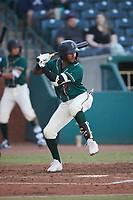 Lolo Sanchez (34) of the Greensboro Grasshoppers at bat against the Hickory Crawdads at First National Bank Field on May 6, 2021 in Greensboro, North Carolina. (Brian Westerholt/Four Seam Images)