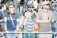 """Counterprotesters hold signs toward, flip-off, and angrily shout at those marching in the Straight Pride Parade in Boston, Massachusetts, on Sat., August 31, 2019. The parade was organized in reaction to LGBTQ Pride month activities by an organization called Super Happy Fun America. The people's t-shirts here read """"Be Gay / Do Crimes"""" and """"Never Stop Punching Nazis."""""""