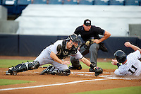 Jupiter Hammerheads J.T. Realmuto #9 attempts to tag Slade Heathcott #11 sliding in as umpire Shane Livensparger looks on to make the call during a Florida State League game against the Tampa Yankees at Legends Field on July 17, 2012 in Tampa, Florida.  Tampa defeated Jupiter 12-0.  (Mike Janes/Four Seam Images)