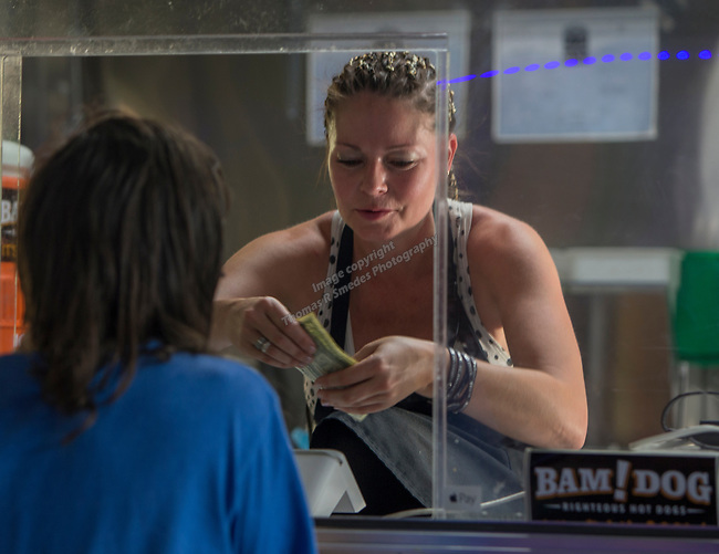 Cierra Bennister working in the Bam!Dog food truck during the Feed the Camel food truck night at the McKinley Arts Center in Reno on Wednesday, June 28, 2017.