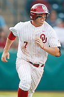 Max Whte (7) runs to first after hitting during the NCAA matchup between the University of Arkansas-Little Rock Trojans and the University of Oklahoma Sooners at L. Dale Mitchell Park in Norman, Oklahoma; March 11th, 2011.  Oklahoma won 11-3.  Photo by William Purnell/Four Seam Images