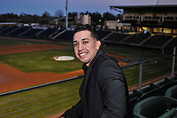 Iggy Suarez, introduced as 2018 manager of the Greenville Drive, sits in the third base stands before the annual Hot Stove Event to promote the upcoming baseball season on Monday, January 29, 2018, at Fluor Field at the West End in Greenville, South Carolina. (Tom Priddy/Four Seam Images)