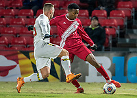 COLLEGE PARK, MD - NOVEMBER 15: Ben Di Rosa #25 of Maryland defends against Herbert Endeley #17 of Indiana during a game between Indiana University and University of Maryland at Ludwig Field on November 15, 2019 in College Park, Maryland.