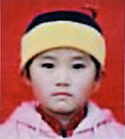 Liu Kaixue (7), born in 1995. Missing at Qian County in Shaanxi Province on 04 Feb 2002.    Girls in China are increasingly targeted and stolen as there is a shortage of wives as the gender imbalance widens with 120 boys for every 100 girls..PHOTO BY SINOPIX