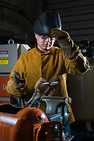 New welding student Chris Gilbert learns the basics of using a plasma cutter in James Selkirk's welding class inside the Industrial Arts Building at UAA's Kodiak College.