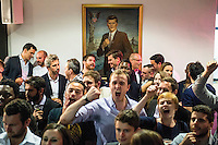 Fans chat and cheer beneath a portrait of John F. Kennedy at a white collar boxing event at the London Irish Centre where the 'Carpe Diem' boxing event is taking place. <br /> <br /> 'White-collar boxing' is a growing phenomenon amongst well paid office workers and professionals and has seen particular growth in financial centres like London, Hong Kong and Shanghai. It started at a blue-collar gym in Brooklyn in 1988 with a bout between an attorney and an academic and has since spread all over the world. The sport is not regulated by any professional body in the United Kingdom and is therefore potentially dangerous, as was proven by the death of a 32-year-old white-collar boxer at an event in Nottingham in June 2014. The London Irish Centre, amongst other venues, hosts a regular bout called 'Carpe Diem'. At most bouts participants fight to win. Once boxers have completed a few bouts they can participate in 'title fights' where they compete for a replica 'belt'.
