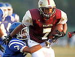 Waterbury, CT-07 September 2012-090712CM06- Sacred Heart's Shyquon Thompson tries to break off a tackle from Crosby's Jayson Morrison during the first quarter at the City Jamboree Friday night at Municipal Stadium in Waterbury.  Sacred Heart won the quarter.     Christopher Massa Republican-American