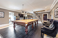 BNPS.co.uk (01202 558833)<br /> Pic: Savills/BNPS<br /> <br /> Pictured: The games room.<br /> <br /> A striking turreted French style chateau in one of the UK's most desirable streets is on the market for £9.25m.<br /> <br /> Deauville is an impressive mansion with a striking period exterior but a stylish contemporary look inside and all the mod cons a home owner would want, including an indoor pool complex and cinema room.<br /> <br /> The house is in the prestigious St George's Hill estate in Weybridge, Surrey, which is renowned all over the world.<br /> <br /> The five-bedroom house was built in 2000 but has undergone an extensive refurbishment in the last few years.