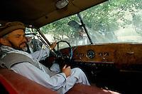 Commander Idi Abdul Tarak in autumn 2001, on the driving seat of the English black Austin A135 Princess Vanden Plas Limousine in the Panshir Valley.