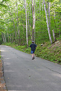 Man jogging on Weeks State Park Road in Lancaster, New Hampshire. This road leads to the John Wingate Weeks Estate on the summit of Mt. Prospect. Built in the early 1900s (1912) for John Wingate Weeks, this early 20th-century estate was given to the state of New Hampshire in 1941 by Weeks' children.