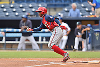 Hagerstown Suns center fielder Victor Robles (16) runs to first during a game against the Asheville Tourists at McCormick Field on June 6, 2016 in Asheville, North Carolina. The Tourists defeated the Suns 12-10. (Tony Farlow/Four Seam Images)