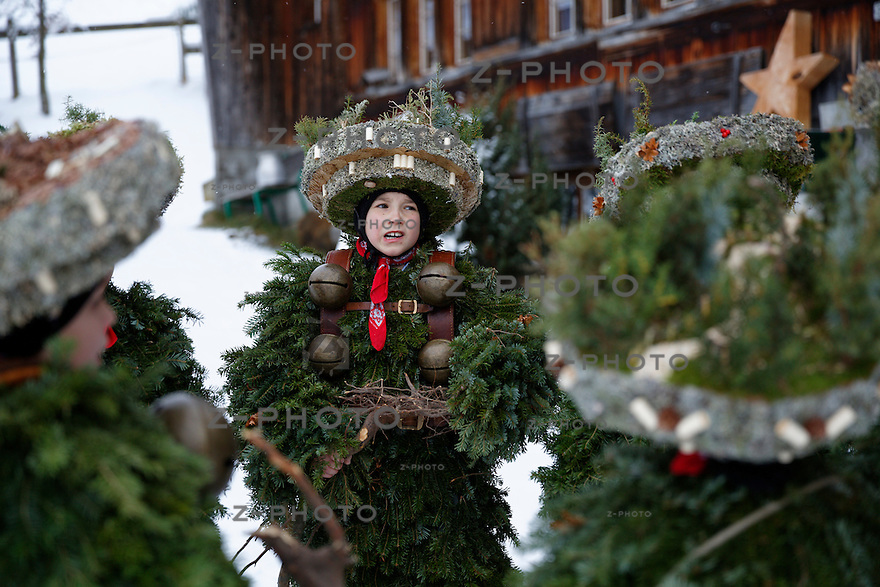 "Silvester Chlaeuse am 13. Januar 2013 unterwegs in und um Urnaesch in Appenzeller Aussenrhoden. ""die Schoenen, die Wuesten-Schoenen und die wuesten"" Gruppen wuenschen den Einwohnern ein gutes neue Jahr <br /> <br /> On 13 January, «Old New Year's Eve», the «Chläuse» make their way around the Appenzell hinterland. Silvesterchlausen is an impressive winter festival with pagan roots, celebrated on the new and old day of New Year's Eve in a few towns in the Canton of Appenzell Ausserrhoden. <br /> <br /> Copyright © Zvonimir Pisonic"