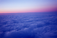 Clouds and sunset viewed out airplane window<br />